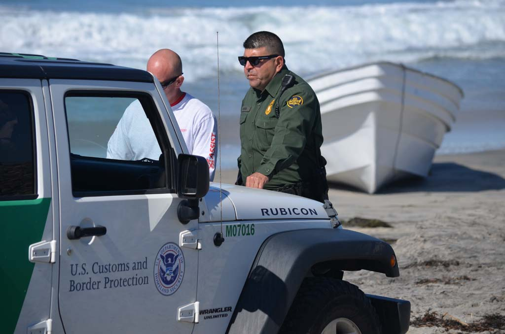 """Trying to catch maritime smugglers has become a """"cat-and-mouse game,"""" says Michael Cariker, a Border Patrol supervisory agent. With the land border becoming more secure, many smugglers have taken to the seas to traffick in drugs, using panga boats, such as the one pictured in the background during a smuggling attempt in Carlsbad last year. File photo"""
