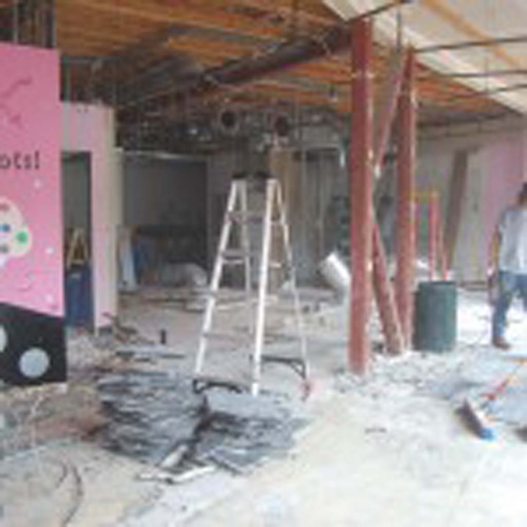 Crews work to transform a former cupcake shop into a craft beer tap room. BeerWorks is slated to open in April in the Beachwalk Center in the first-floor space previously occupied by Cupcake Love. Photo by Bianca Kaplanek