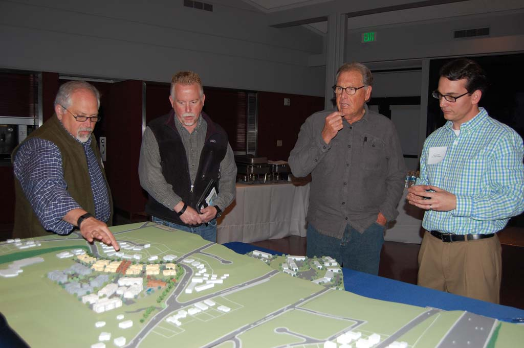 Project manager John La Raia, right, discusses plans to revitalize Solana Highlands with area residents during a March 4 open house. The 3-D model can be viewed at the leasing office from 4:30 to 5:30 p.m. every other Tuesday beginning March 25. Photo by Bianca Kaplanek