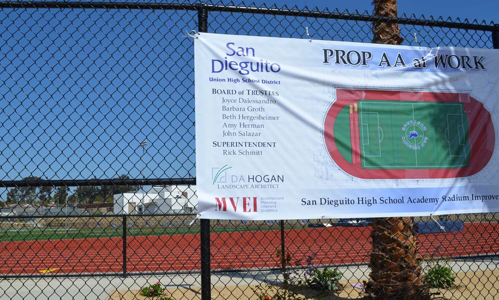 A sign denotes Proposition AA stadium improvements at San Dieguito Academy. The biggest contributors to the $449 million bond campaign were later awarded a contract. But the district believes there are no pay-to-play issues, because firms were prequalified beforehand. Photo by Jared Whitlock