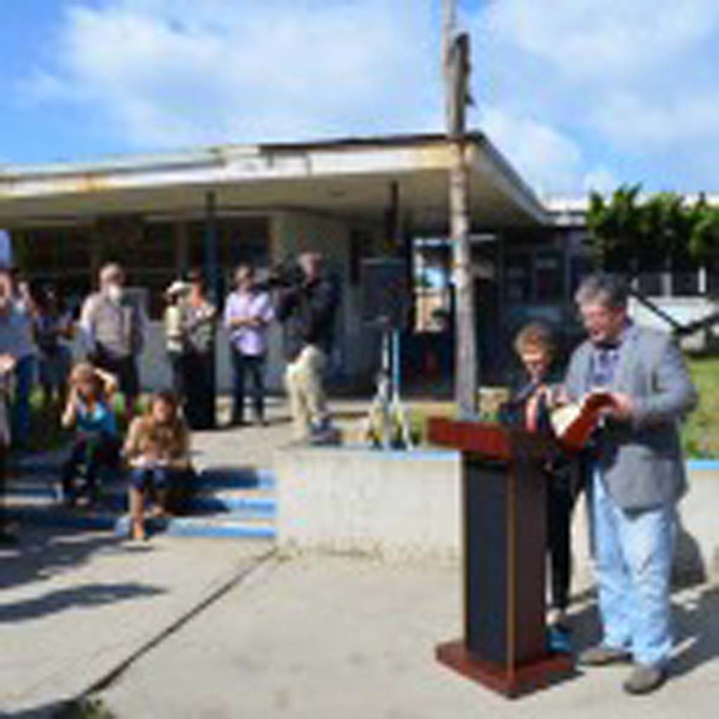 """Councilman Tony Kranz reads the Robert Frost poem """"The Road Not Taken"""" during a press conference announcing the city purchasing the Pacific View site. Kranz said he's glad the city and EUSD could reach a deal, avoiding an """"arduous path."""" Photo by Jared Whitlock"""