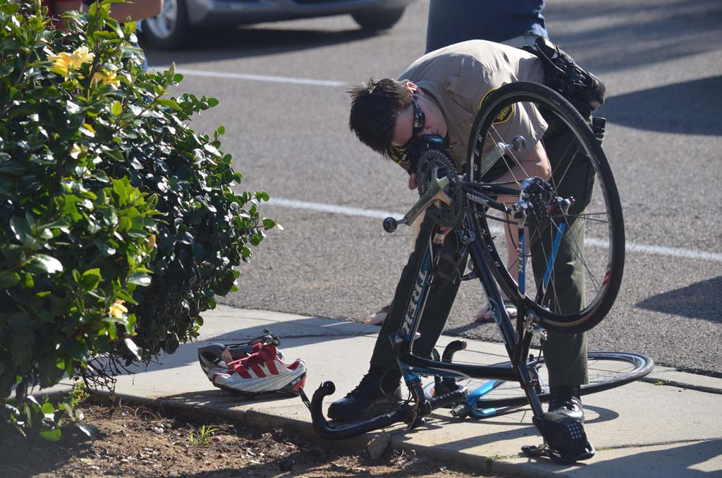 A Sheriff's deputy takes photos at the scene of an accident involving a bicyclist and motorist. It's the second time in two months that a cyclist has been hit by vehicle at the Coast Highway 101 location. Photo by Tony Cagala