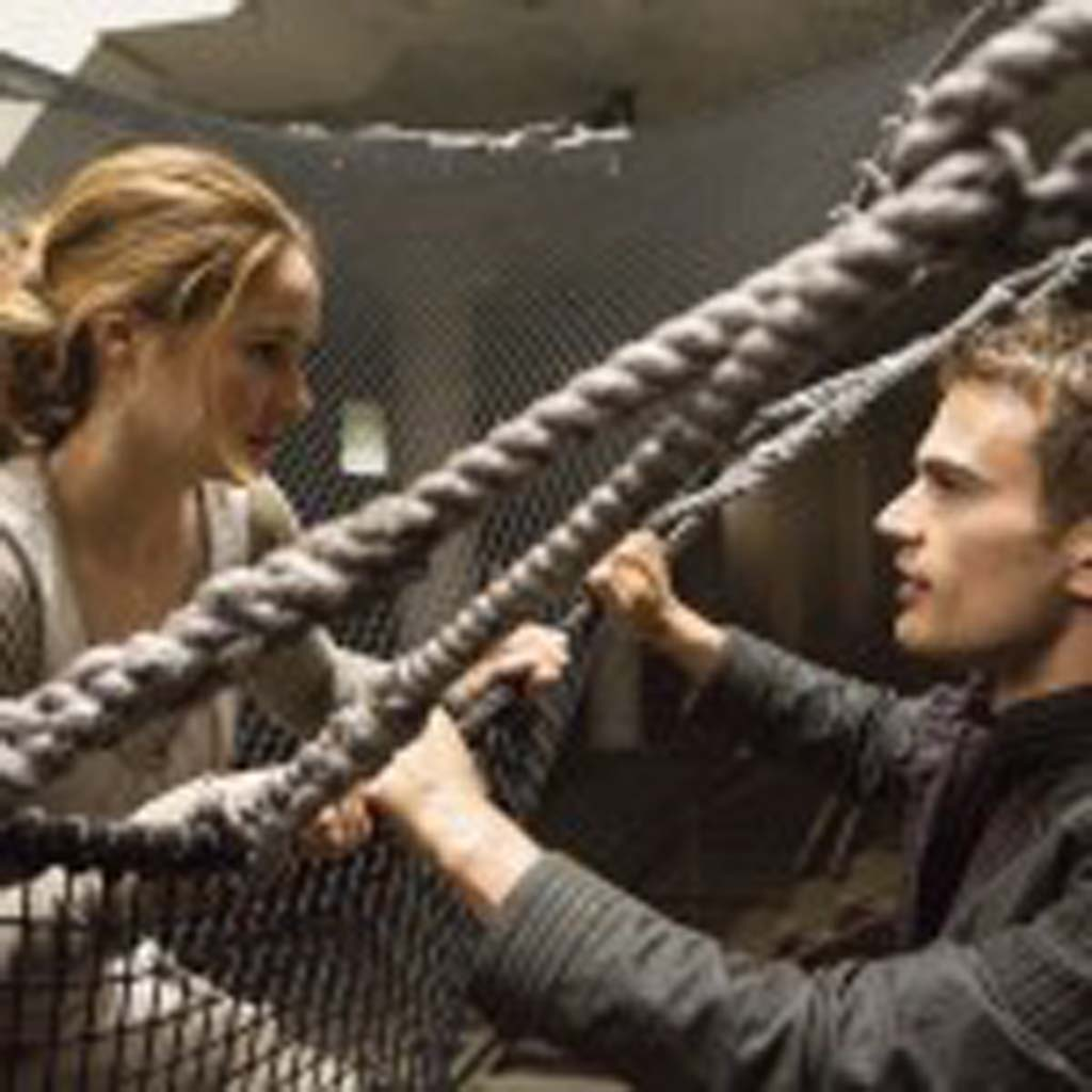 """Tris (Shailene Woodley), and Four (Theo James) in """"Divergent."""" Photo by Jaap Buitendijk"""