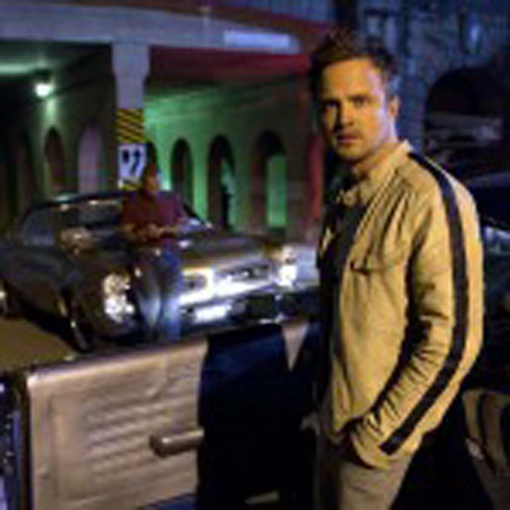 """Tobey Marshall (Aaron Paul) is in a near-impossible cross-country race against time in """"Need for Speed."""" Photo by Melinda Sue Gordon"""