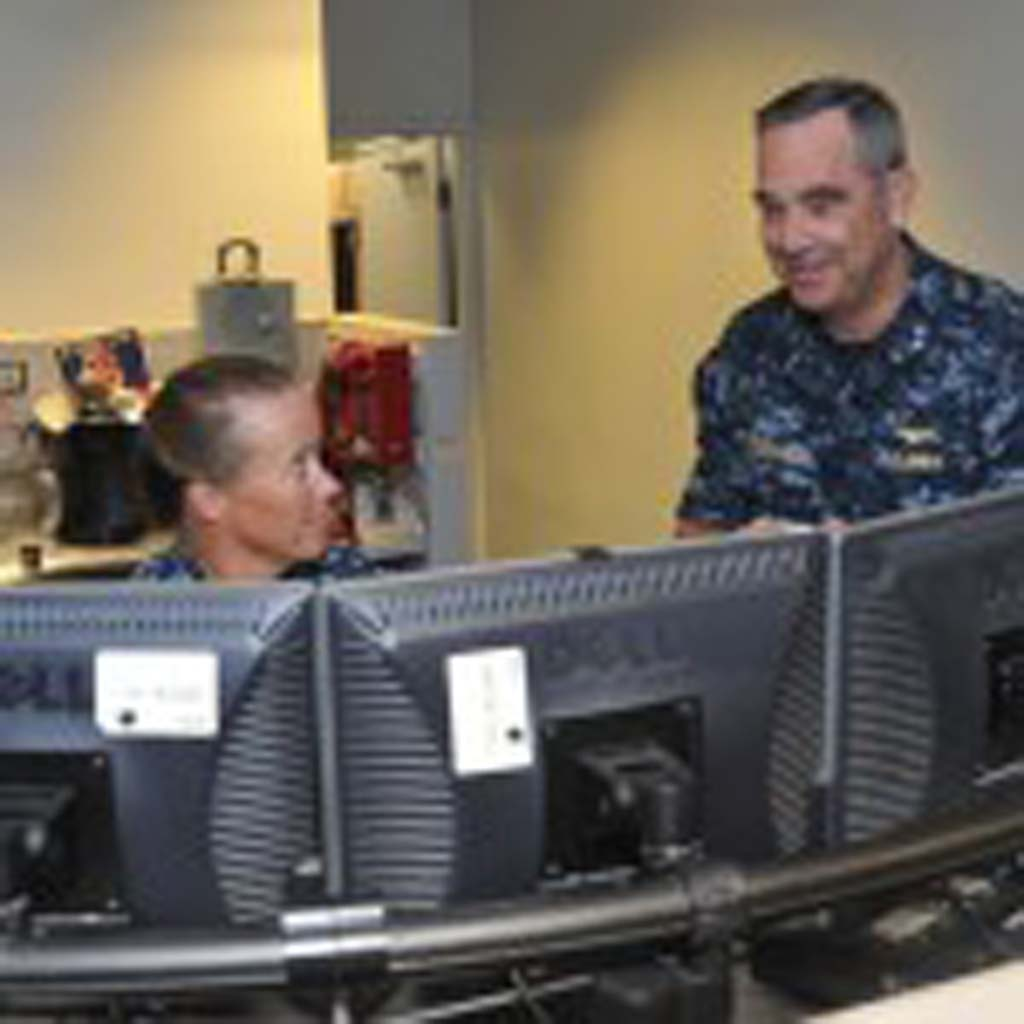 Rear Adm. Russ Penniman, director of Maritime Operations Center, right, discusses current operations with Cmdr. Sara Crawford, the battle watch captain, during a visit to the operations floor at U.S. Pacific Fleet (PACFLT) headquarters. Penniman, a Rancho Santa Fe resident has served in the Navy since 1979. U.S. Navy Photo by Mass Communication Specialist 1st Class David Kolmel