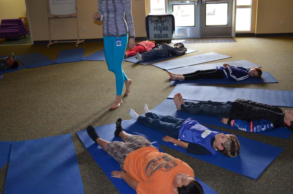 Students at Paul Ecke Central participate in a yoga class. Developed in Encinitas, the program has since spread to New York and Florida. File photo by Jared Whitlock