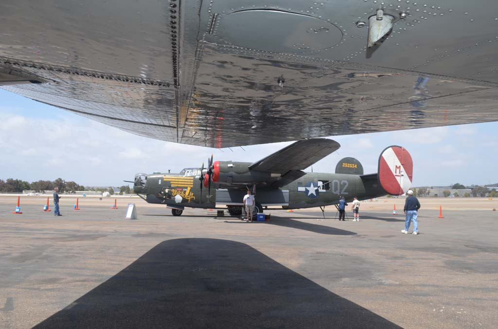 A B-24 Liberator seen from underneath the wing of a B-17 Flying Fortress. The planes were part of the Wings of Freedom tour by the Collings Foundation on April 26 through April 27 in Carlsbad. Photo by Tony Cagala