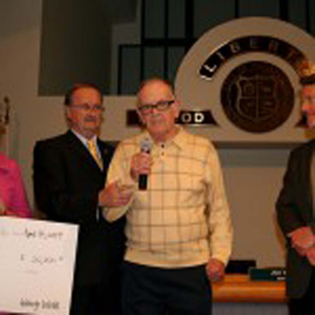 Dick Parker, center, helps the city and builder accept the grant that will fund the Kay Parker Family Resource Center. The late Kay Parker was an advocate for fair housing. Photo by Promise Yee