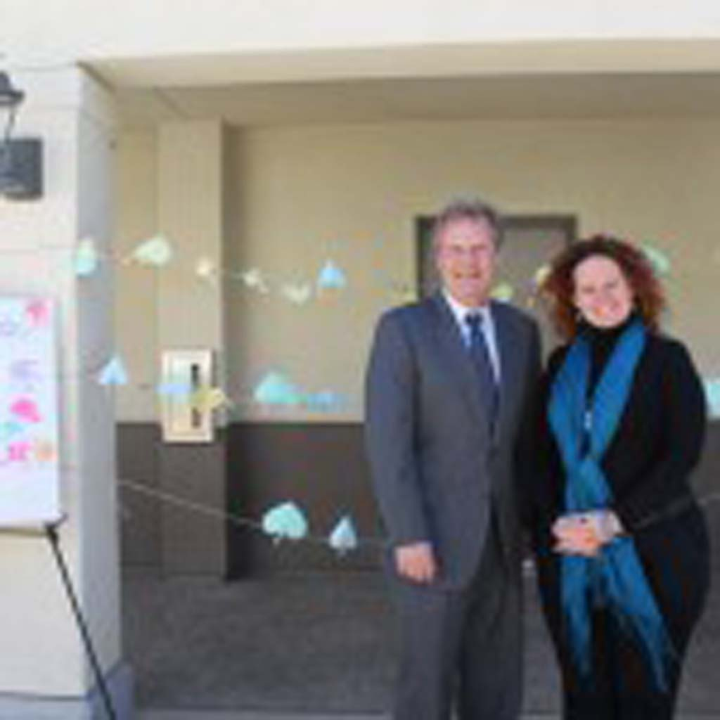 San Marcos Mayor Jim Desmond joins Casa de Amparo Executive Director Tamara Fleck-Myers in front of community pledges made against child abuse and neglect. Courtesy photo