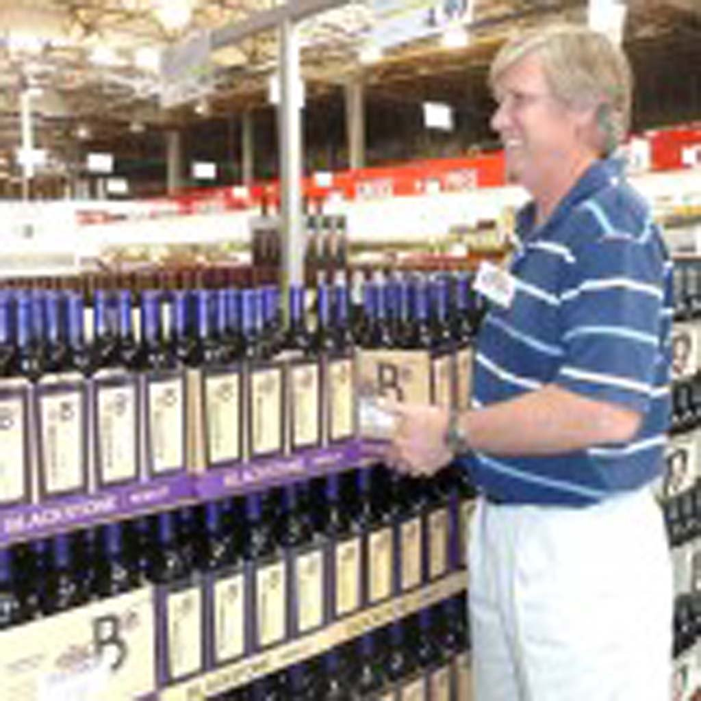 Mathew Allen is the chief bottle-watcher in the wine beer and spirit department at COSTCO Carlsbad. Photo by Frank Mangio