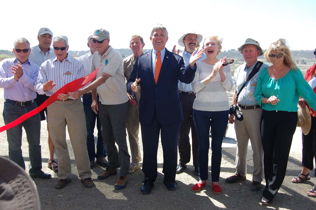 On hand for the ribbon cutting are, from left, David Kay, from Southern California Edison, San Dieguito River Valley Conservancy President Peter Shapiro, San Dieguito River Park Executive Director Dick Bobertz, County Supervisor Dave Roberts, his predecessor Pam Slater-Price, San Dieguito River Valley Conservancy Executive Director Trish Boaz and members of the conservancy and joint powers authority. Photo by Bianca Kaplanek