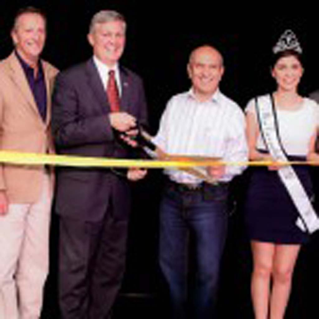From left: President and CEO of Escondido Chamber of Commerce Rorie Johnston, Escondido City Council member Ed Gallo, County Supervisor Dave Roberts, Escondido Mayor Sam Abed, Miss Escondido 2014 Erica Barnes, and California Center for the Arts, Escondido board member Robert Cafaro celebrate the ribbon cutting of Studio One on May 8. Photo courtesy of Alyss Charles of Honey Photographs by Alyss