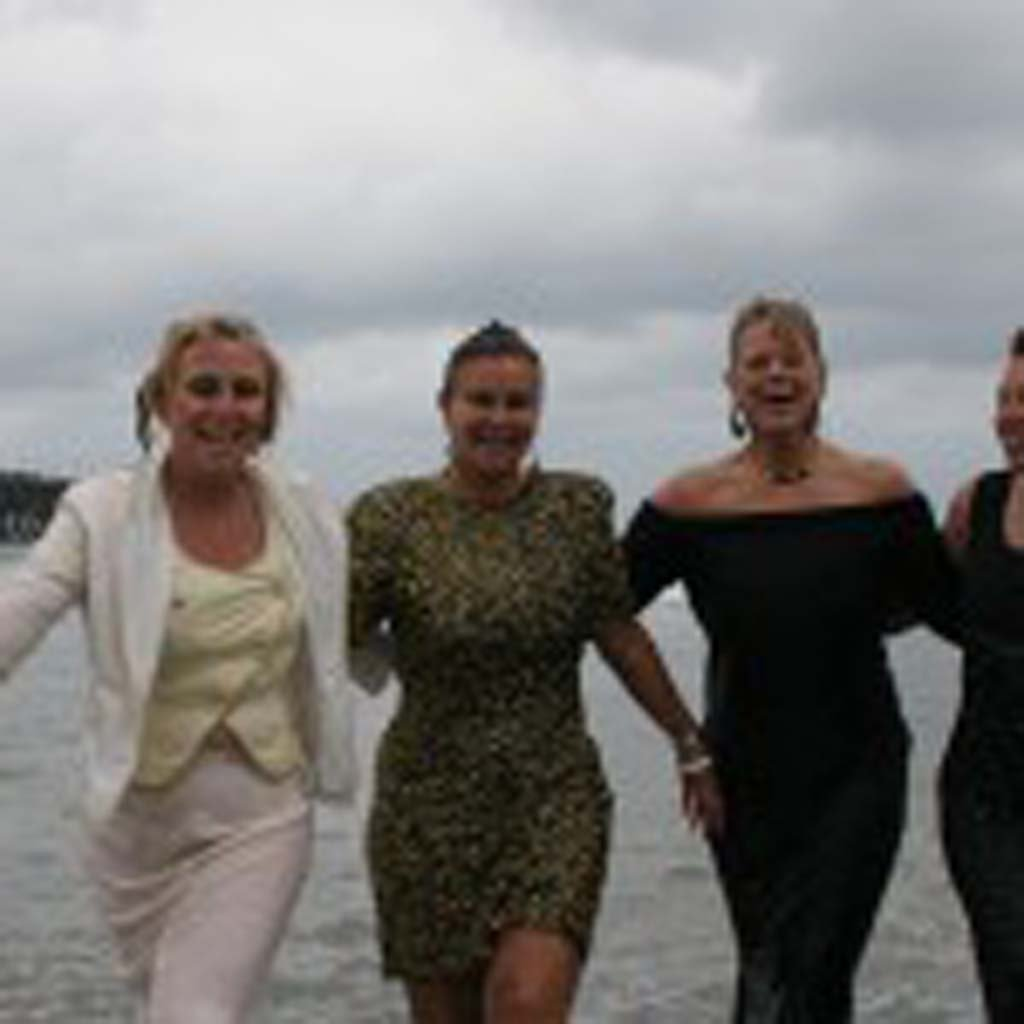 The Mother's Day Fancy Dress Swim in an annual Oceanside tradition. Marlaine Paulsen Cover, third from left, initiated the fundraiser six years ago. Photo by Promise Yee
