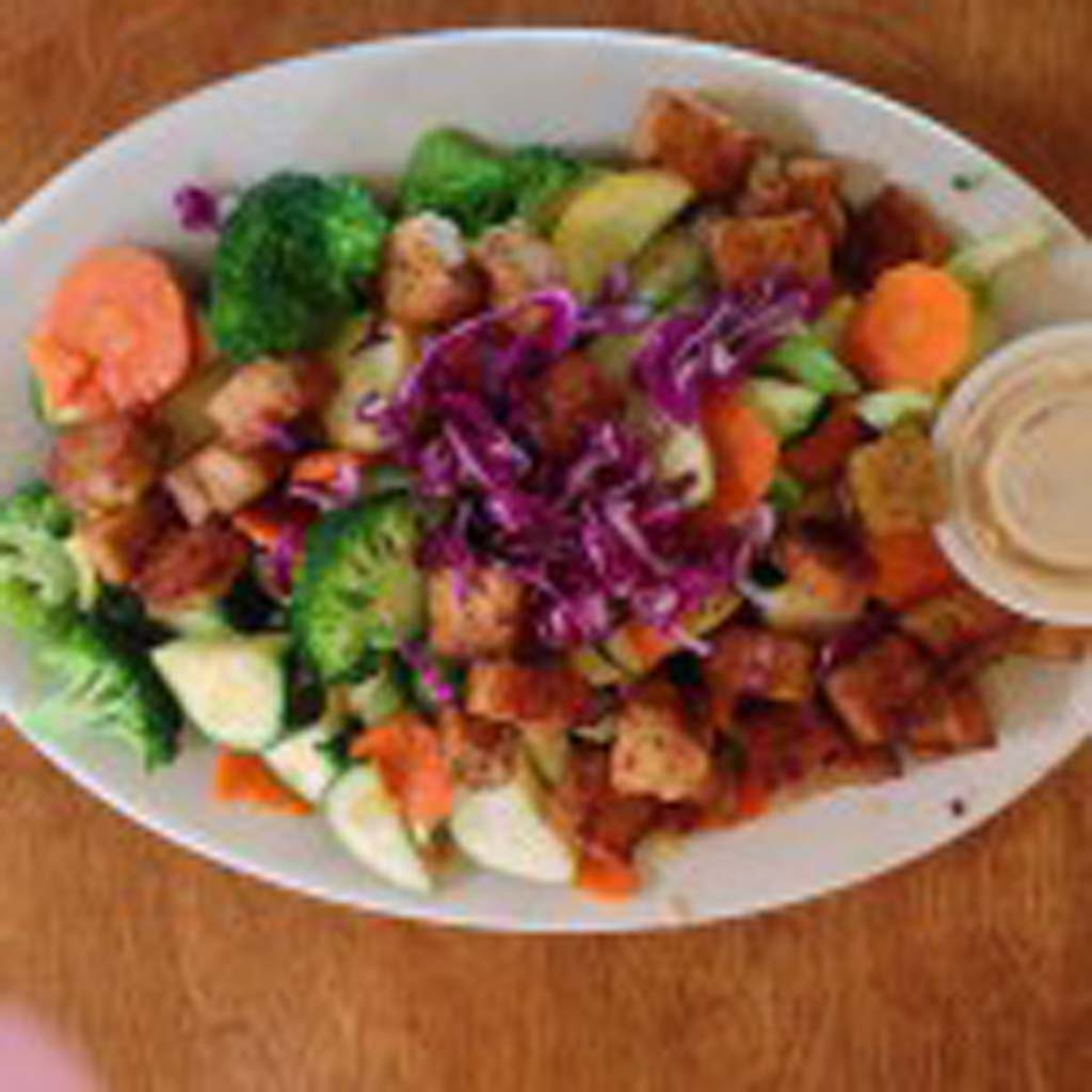 Fresh seasonal vegetables and Tempeh, served over brown rice with tahini-ginger sauce. Photo Courtesy John Grimshaw