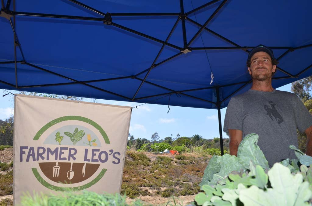 Ryan Goldsmith, a former chef, turned away from cooking to become a farmer. He's opened Farmer Leo's, a roadside certified organic farm stand in Encinitas last week. Photo by Tony Cagala