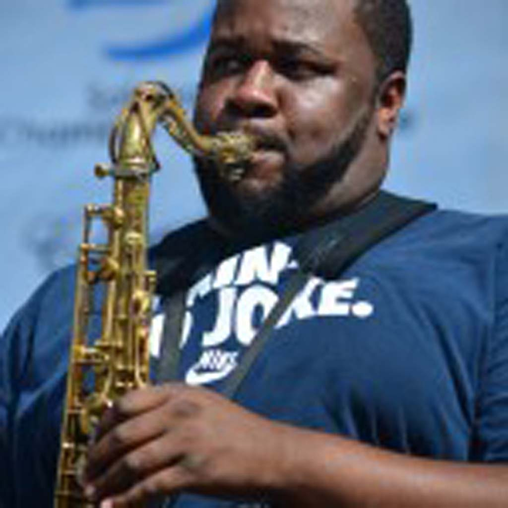 """The Soul Rebels' saxophonist Erion Williams leads the band in a cover of the Eurythmics' """"Sweet Dreams (Are Made of This),"""" on Saturday. Photo by Tony Cagala"""