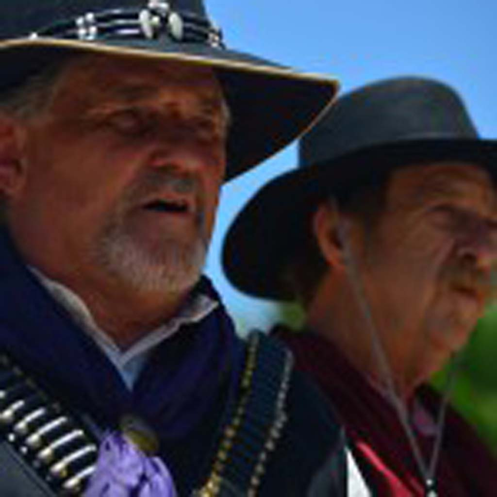 """Sheriff Bob """"Cheyenne"""" Callen, left, and Larry """"Black Powder"""" Kaserman try to resolve some bad guy trouble peacefully. Photo by Tony Cagala"""