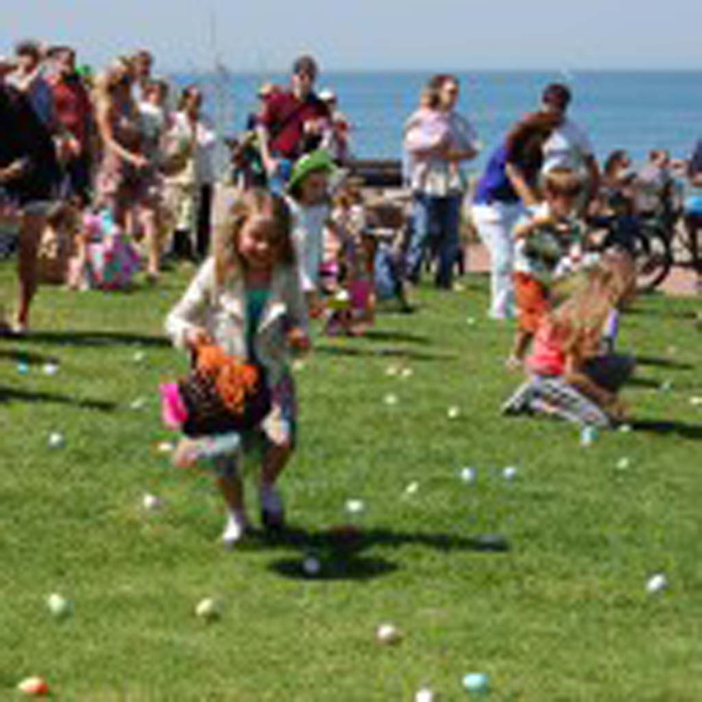 Youngsters scramble to collect eggs during an annual Easter egg hunt, one of many free community events hosted by the Del Mar Foundation. File photo by Bianca Kaplanek