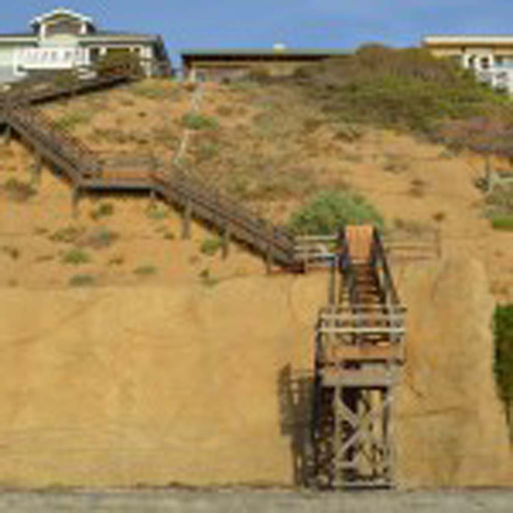 The Fourth District Court of Appeals heard the Coastal Commission's appeal to a lower court ruling on Monday, overturning both the reconstruction of a private staircase and the state agency's imposition of a clause that would require two Encinitas residents to reapply for a permit for their seawall after 20 years. File photo