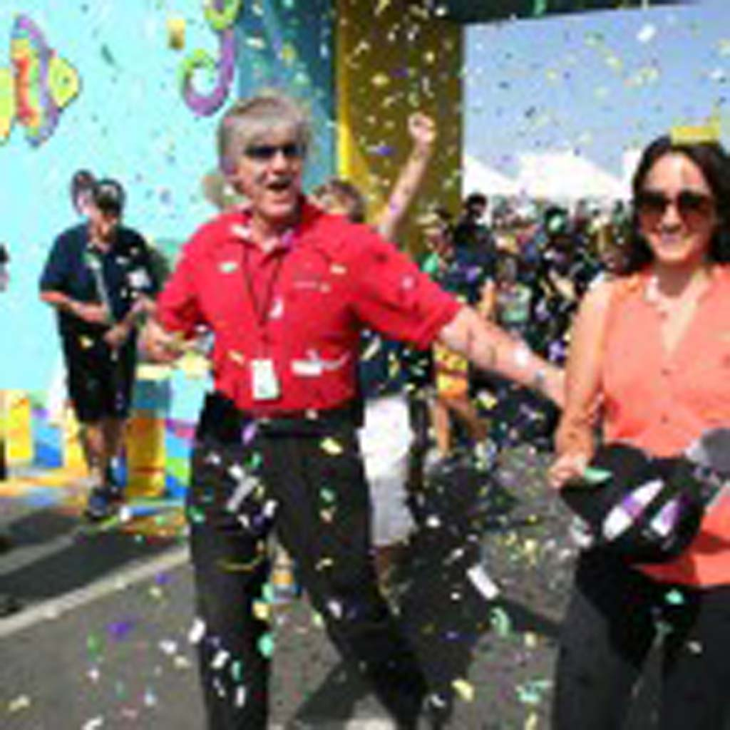 Del Mar Fairgrounds CEO Tim Fennell, left, congratulates Encinitas resident Tania Cotta on June 29. Cotta was the millionth guest to the fair and won tickets for life. Courtesy photo