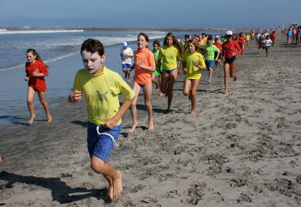 Junior lifeguards race across the beach. Top finishers move on to regional competition in Huntington Beach. Photo by Promise Yee