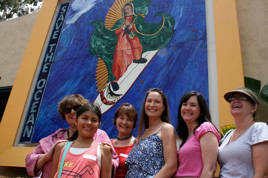 The Snavely family, from left: Nancy Snavely, Sophia Snavely, Julia Chadwell, and the Snavely sisters, celebrate a memorial brick dedicated to Allan Snavely. The family said Allan had a special connection to the Surfing Madonna. Photo by Promise Yee