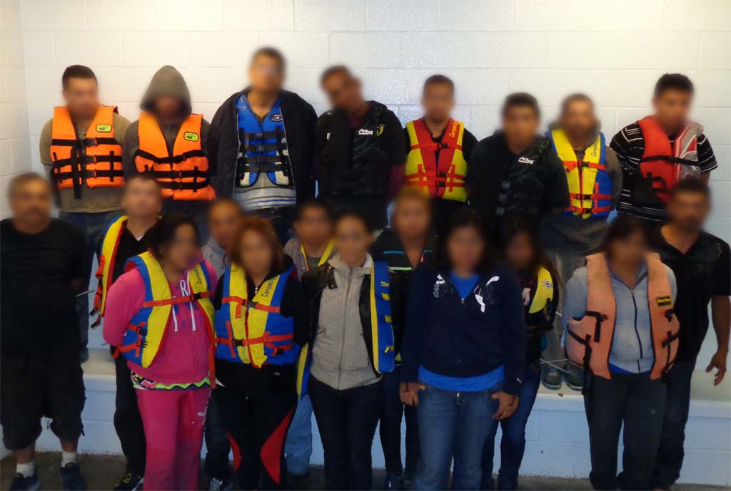Thirteen men and seven women were arrested — two men will be charged with human smuggling. Photo courtesy U.S. Customs and Border Protection's Office of Air and Marine