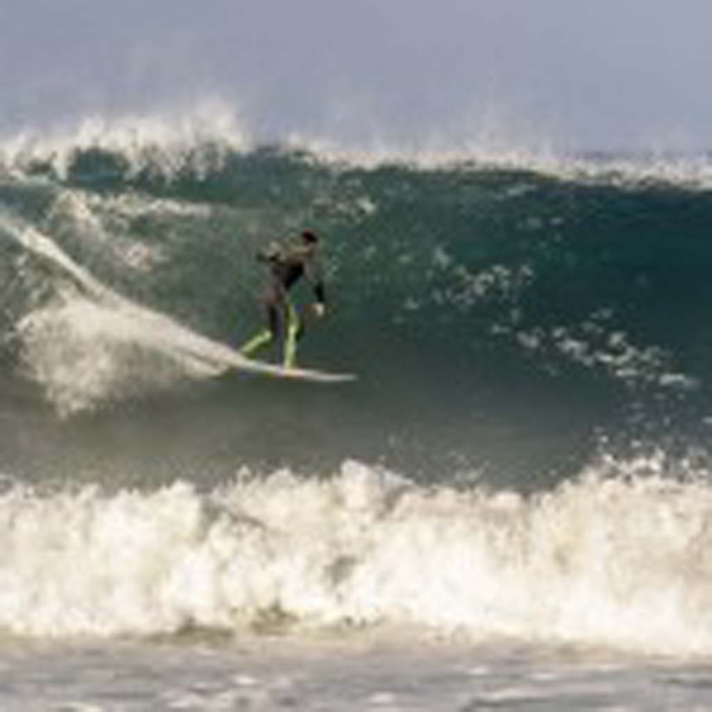 Surfer Andy Carr on Sunday at a North County beach. Photo by Bill Reilly