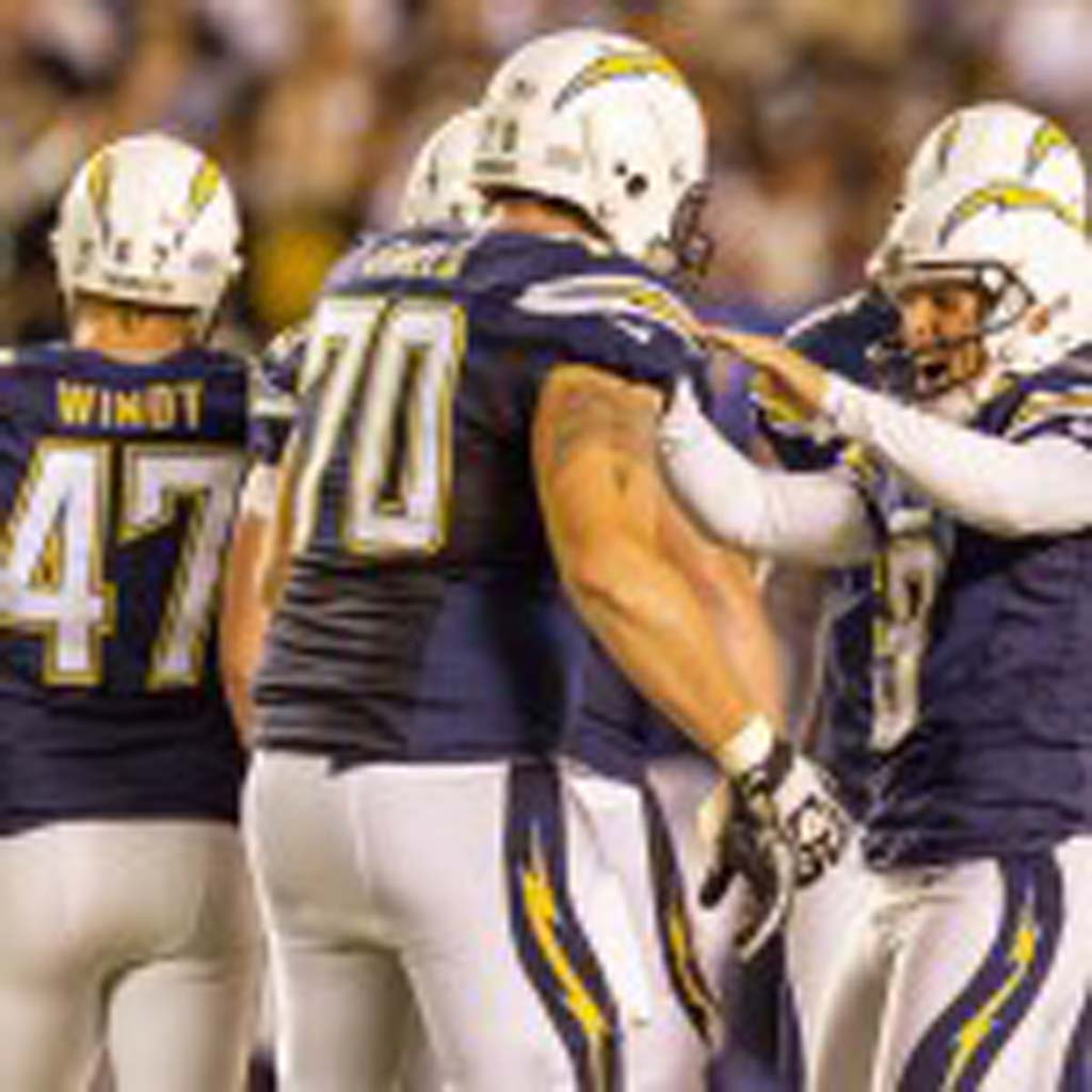 San Diego Chargers kicker Nick Novak (9) gets congratulations after kicking a 55-yard field goal at Qualcomm Stadium. Photo by Bill Reilly