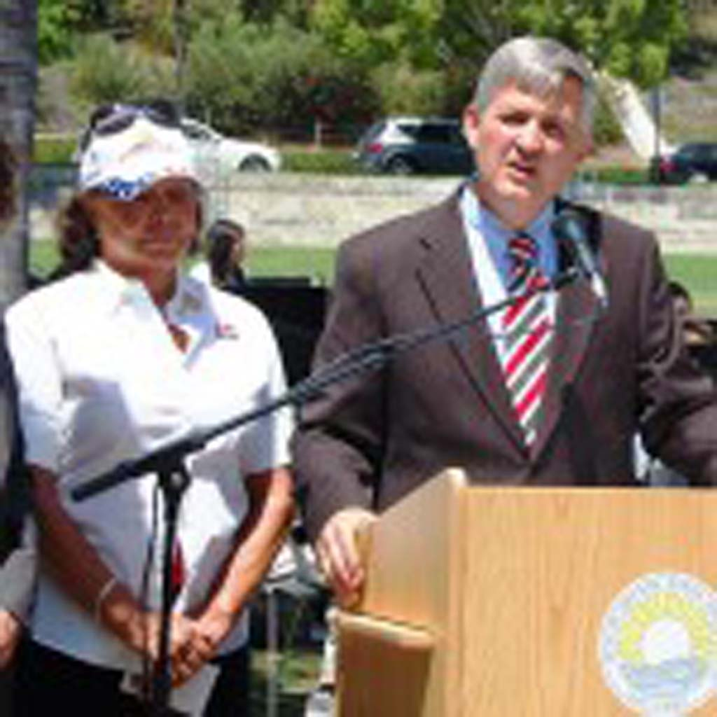 County Supervisor Dave Roberts announces at the 2014 Memorial Day celebration that he will allocate $80,000 to help build a Veterans Honor Courtyard at La Colonia Park. The grant was approved by his colleagues July 29. Looking on are Councilwoman Lesa Heebner, left, and former Mayor Tere Renteria. Photo by Bianca Kaplanek