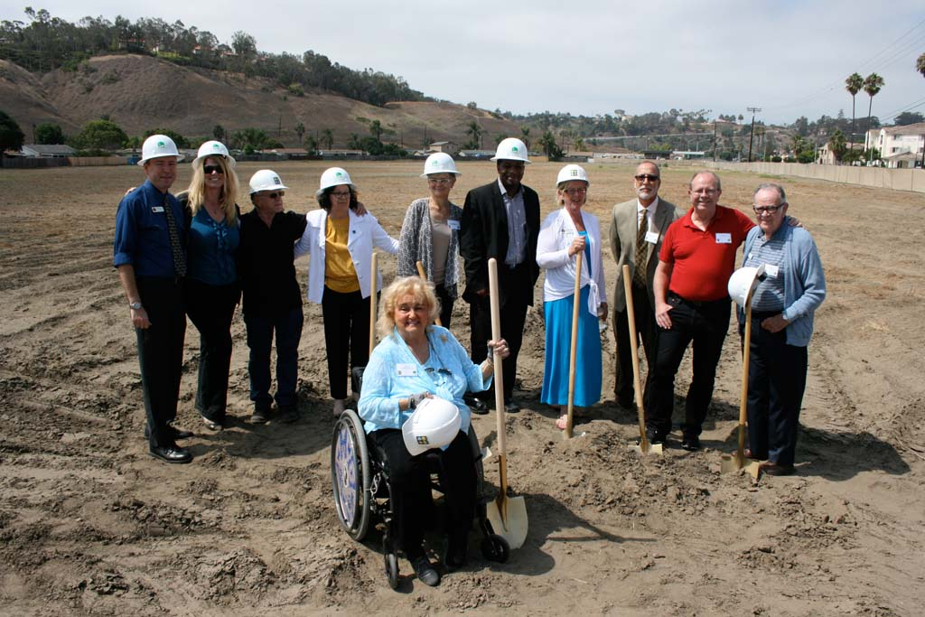 City staff, developers and housing commissioners cheer the groundbreaking at Mission Cove. First occupants are anticipated to move into the affordable housing project in two years. Photo by Promise Yee