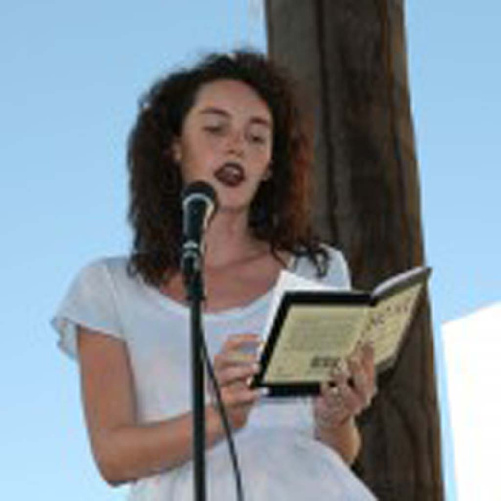 """Reader Sophia Farmer shares a poem from the banned book """"Howl and Other Poems."""" Banned book week was celebrated Sept. 21 to Sept. 27, and continues as a monthlong focus at Oceanside Public Library. Photo by Promise Yee"""