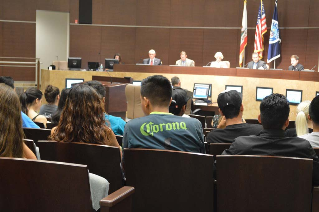 Students listen to Vista City Council members discuss whether to approve a permit for a 7-Eleven to sell alcohol. The Council voted 3-2 to approve the permit. Photo by Sandy Coronilla