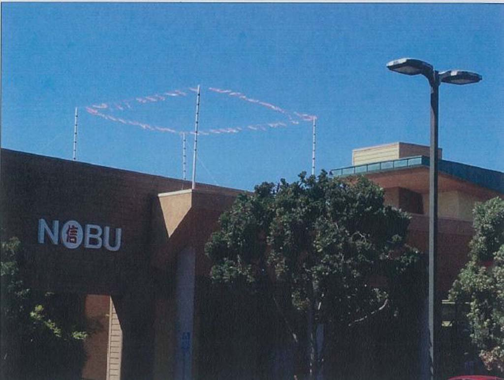 Story poles show what a proposed 35-foot wireless communications facility atop the CVS Pharmacy would look like. Council approved a project that is 2 feet shorter. Courtesy image