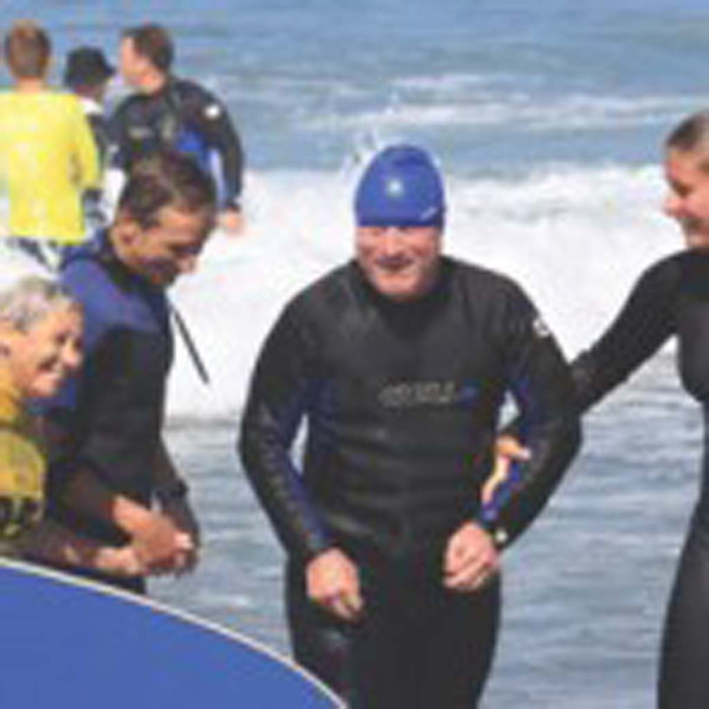 Smiles all round as the first few waves are completed. Photo by Bob Coletti