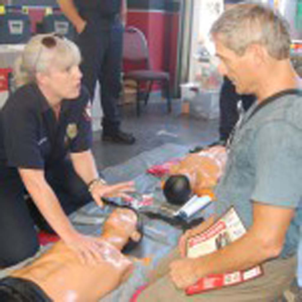 Stuart Volkow gets a CPR lesson from Mary Murphy of the Rancho Santa Fe Fire Department. Photo by Bianca Kaplanek
