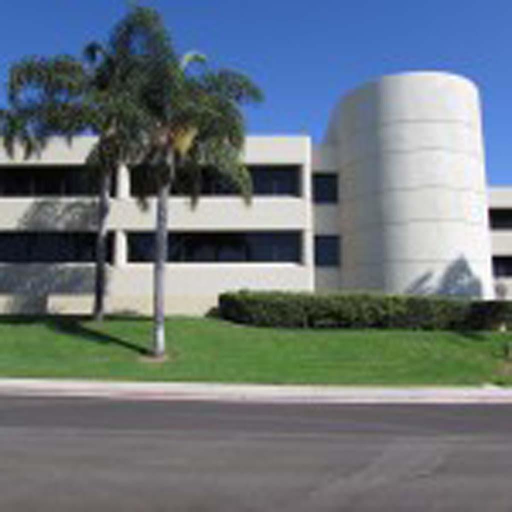 The building on the corner of Faraday Avenue and El Camino Real has been vacant for 15 years, says President of Carlsbad Chamber of Commerce Ted Owens. The site may be used for a new higher education satellite campus. Photo by Ellen Wright
