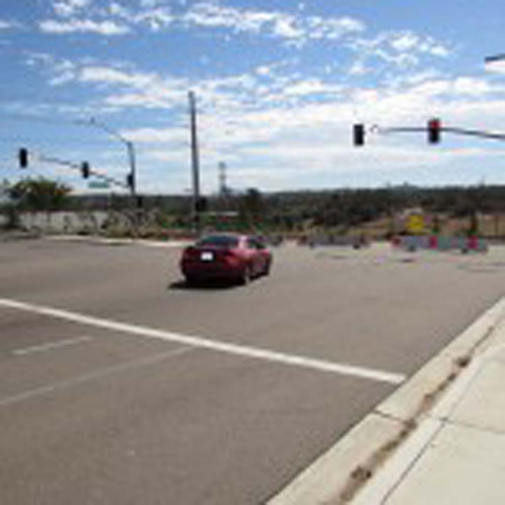 A commuter is forced to turn left onto Andreasen Drive at the end of Citracado Parkway. The proposed link will connect the parkway between Harmony Grove Village Parkway and Andreasen Drive. Photo by Ellen Wright.