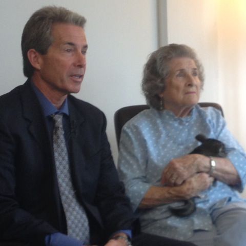 Encinitas attorney Michael Curran, left, with his client Lurlie Adams, who is fighting back against PETA after being accused of animal cruelty on her chinchilla ranch in North County. Photo by Aaron Burgin