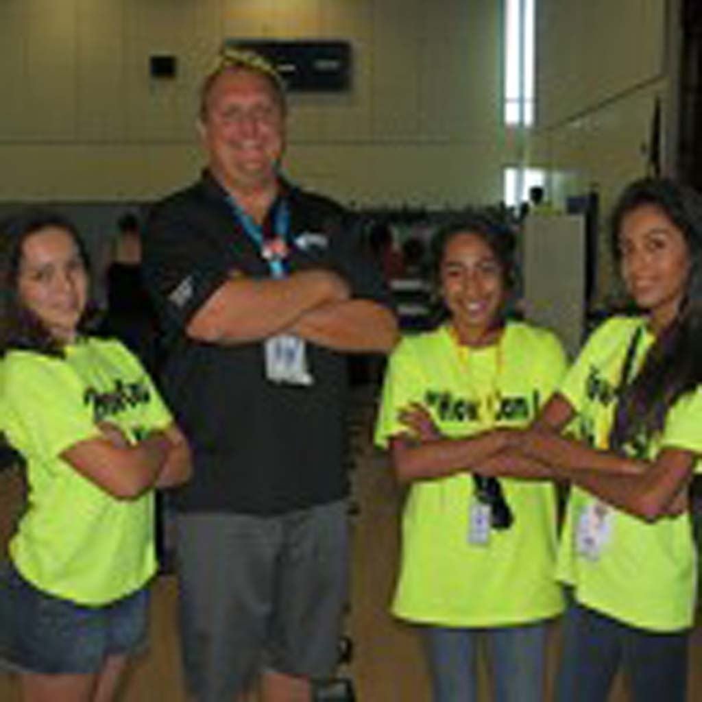 Vista Innovation and Design Academy Principal Eric Chagala, second from left, and seventh grade students Krisiana Humann, Destanae Torres, and Alena Kasiguran are ready to help students through the iPad check out process. Students check out iPads for the school year much like a library book. Photo by Promise Yee
