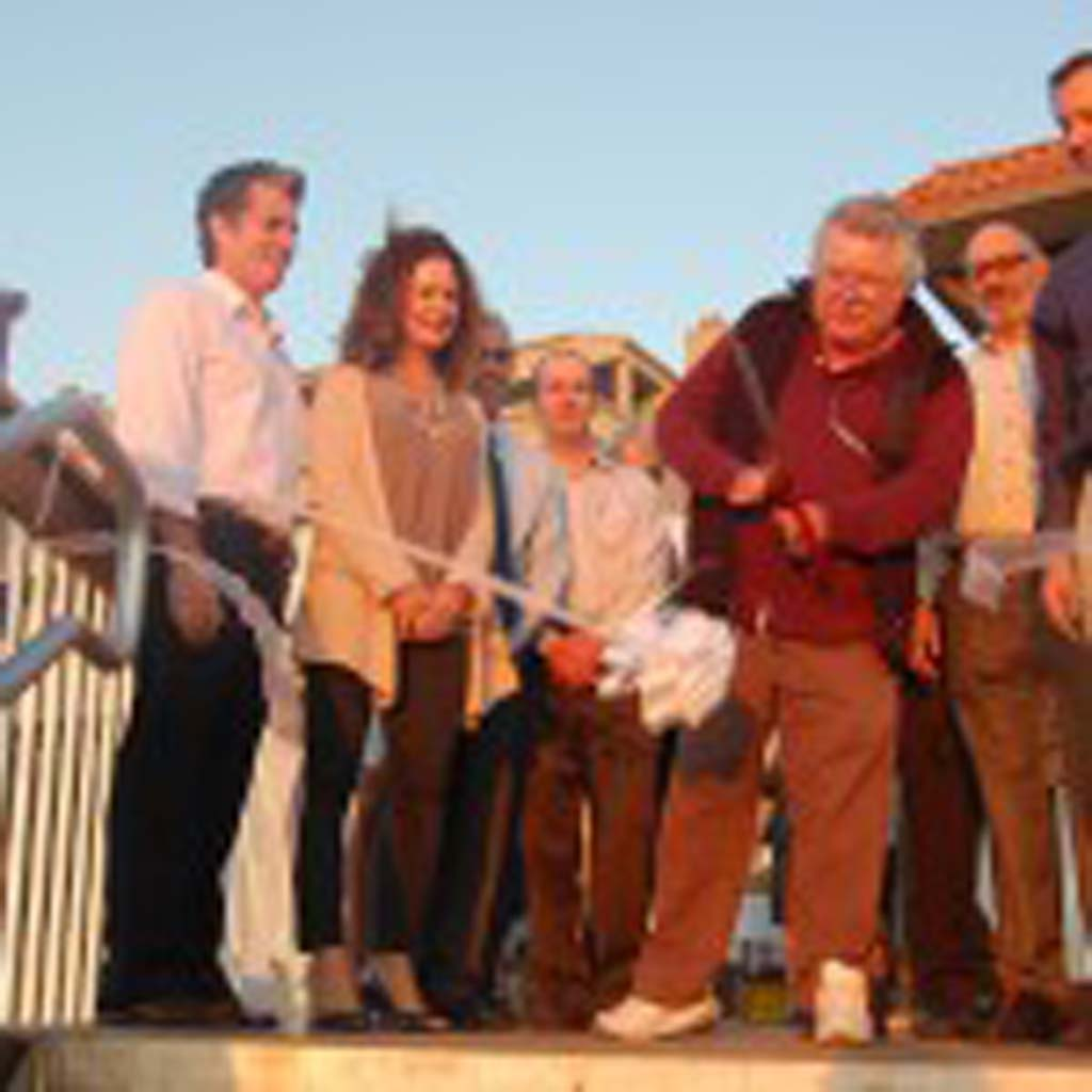 City council members look on as Mayor Tom Campbell cuts the ribbon to commemorate the completion of the new Del Mar Shores beach access stairway. Photo by Bianca Kaplanek