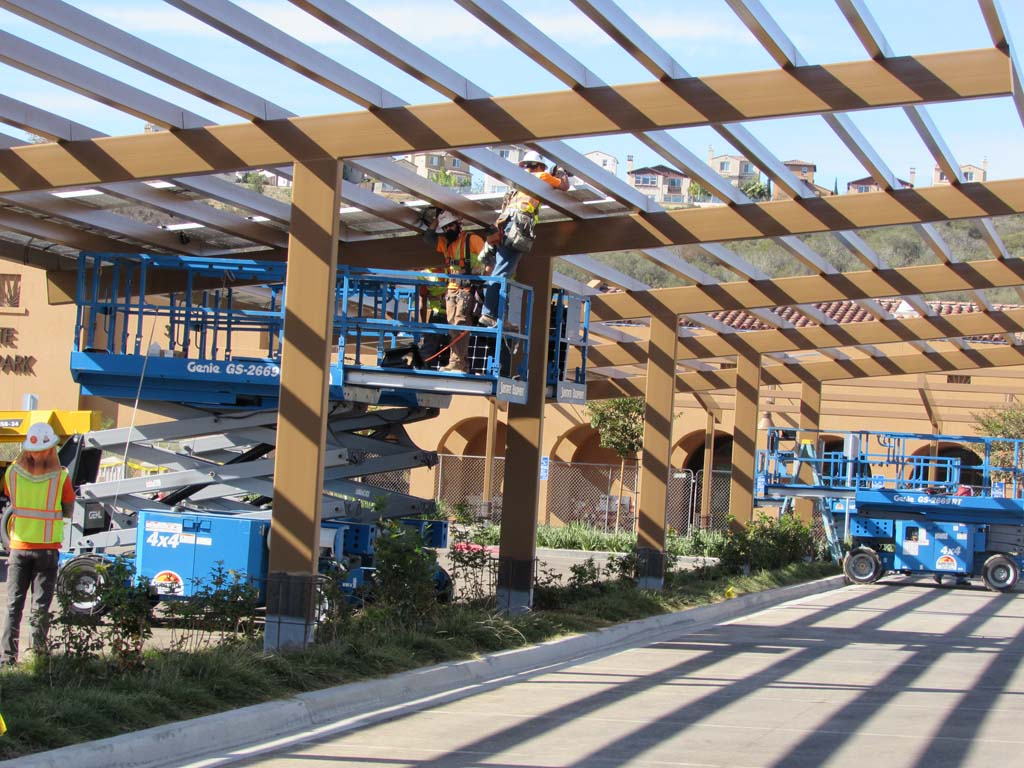 Solar panels are being installed at Alga Norte Community Park to provide energy for the park. They're expected to last 30 years and pay for themselves by 2026. Photo by Ellen Wright