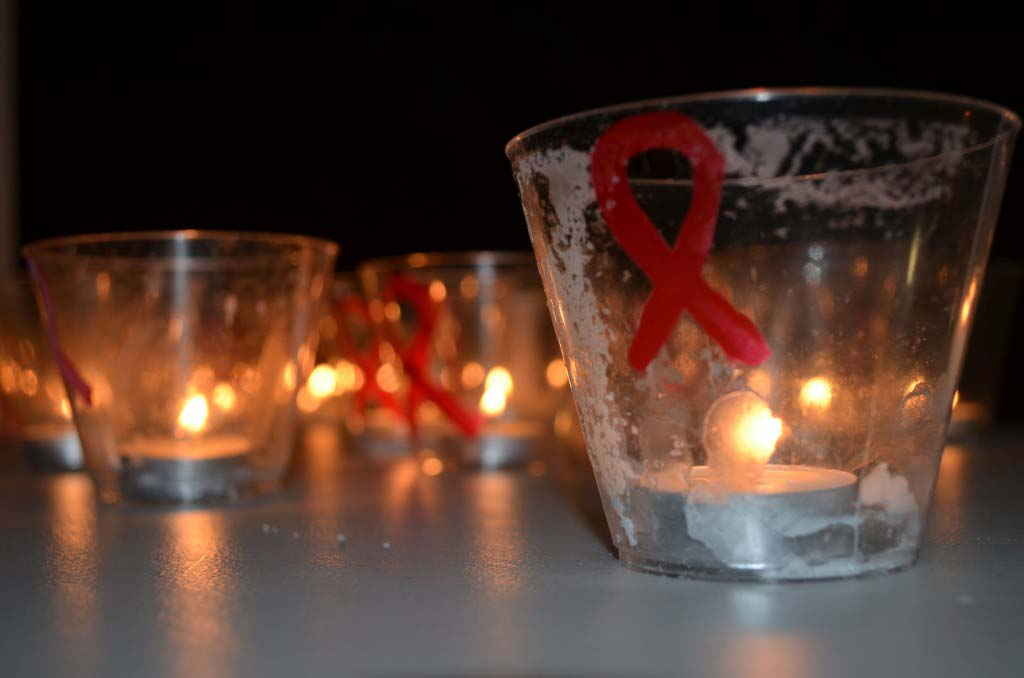 A candlelight vigil memorializes North County who died of AIDS in 2014. File photo by Tony Cagala