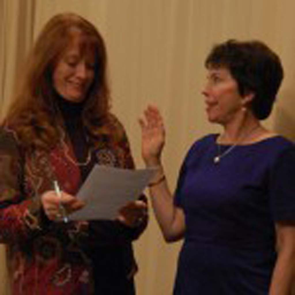 Lee Haydu is sworn into office in December 2010 by then-City Clerk Mercedes Martin. Haydu chose not to seek a second term and was recognized for her leadership, empathy and fairness during her final council meeting Dec. 2. File photo by Bianca Kaplanek