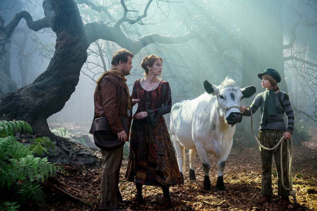 """The Baker (James Corden), left, and his Wife (Emily Blunt) meet Jack (Daniel Huttlestone) and his cow, Milky Way, in the woods, in Disney's """"Into the Woods,"""" opening Dec.25. Photo by Peter Mountain"""