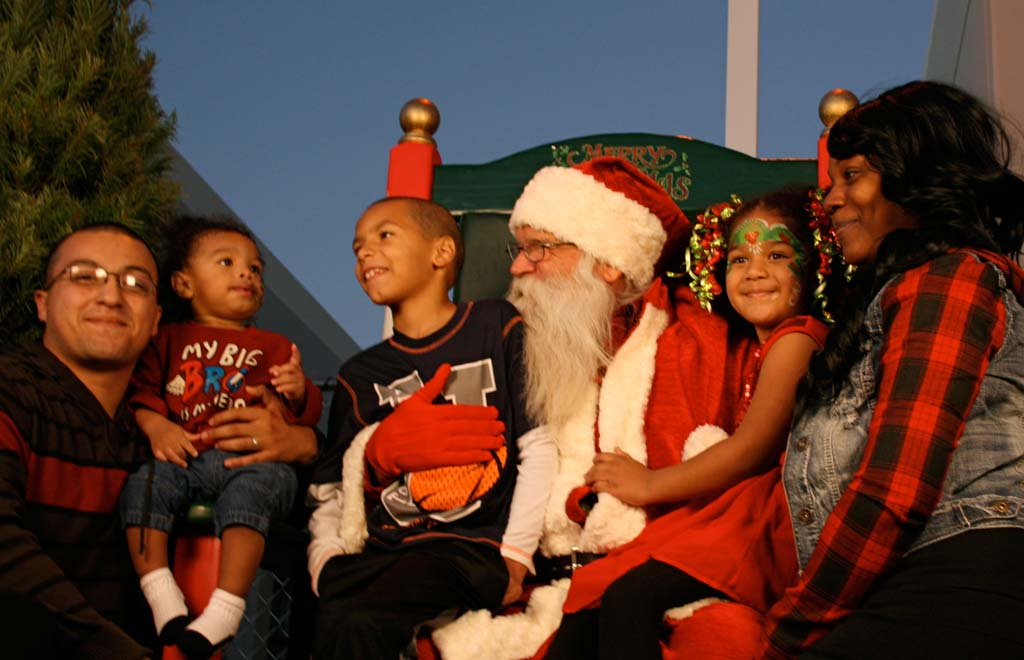 The Copado family of Oceanside snuggles in for a photo with Santa. Other holiday fun included complimentary hot cocoa and a train ride. Photo by Promise Yee
