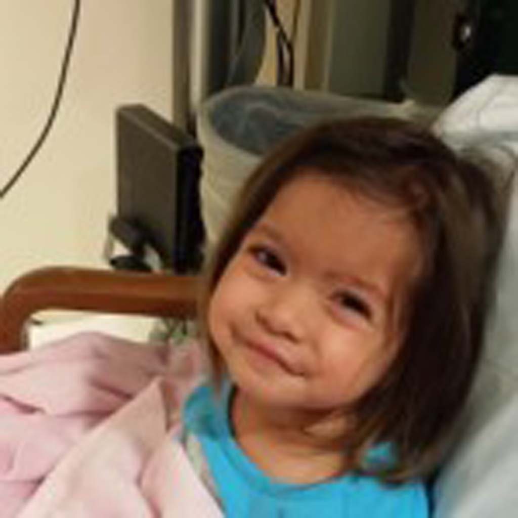 """Kathryn Child knows there's something wrong, but somehow """"through everything she manages to just still be happy and cheerful and playful and charm the heck out of anybody she meets,"""" her father Brian Child says. The family is hoping to find a stem cell donor to complete a transplant for their daughter. Courtesy photo"""