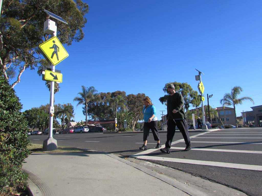 Senior Traffic Engineer Doug Bilse says plans are in the works to add more rectangular rapid flashing beacons, like the one on Oak Avenue, throughout the city. Photo by Ellen Wright