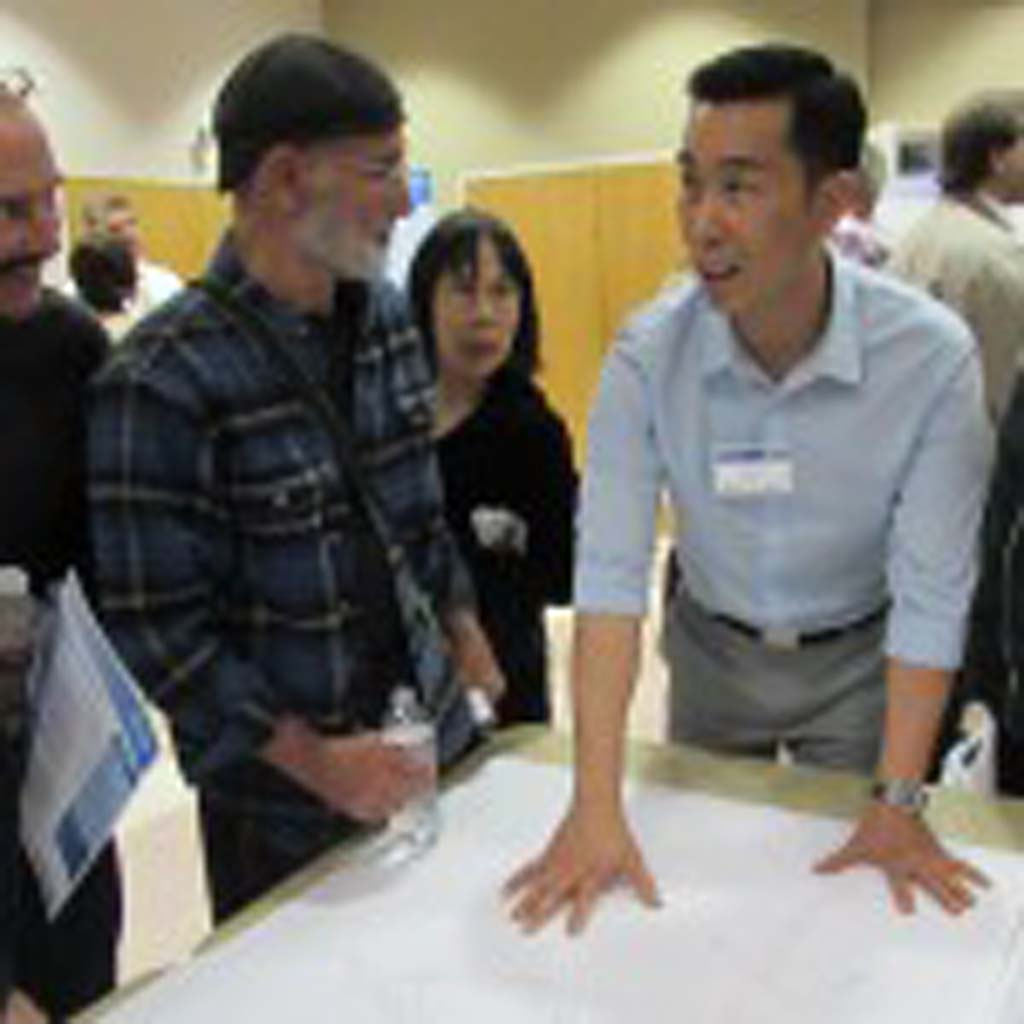 Caltrans Project Developer Levy Le answers questions from the public on interchange possibilities. Photo by Ellen Wright