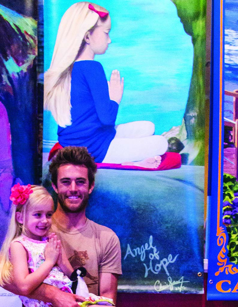 """Christopher Law reveals his """"Angel of Hope"""" and the young girl who inspired the painting at the Arts Alive unveiling. Photo by Greg Nicolayeff Photography"""